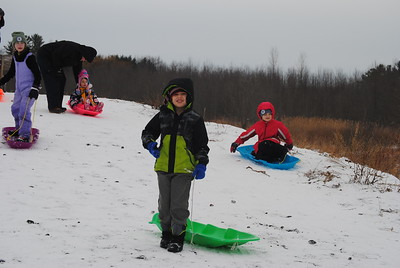 Leah McDonald - Oneida Daily Dispatch Kids go sledding at the Winter Hibernation Festival at the Great Swamp Conservancy in Canastota, N.Y., on Saturday, Feb. 11, 2017.