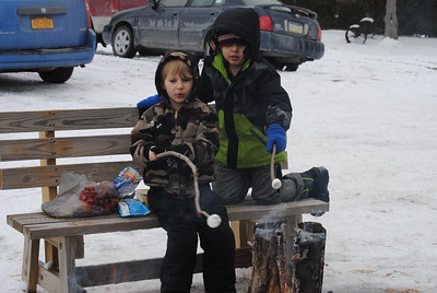 Leah McDonald - Oneida Daily Dispatch Damian Kimball, 4, left, and Cecil McDonald, 6, roast marshmallows at the Winter Hibernation Festival at the Great Swamp Conservancy in Canastota, N.Y., on Saturday, Feb. 11, 2017.