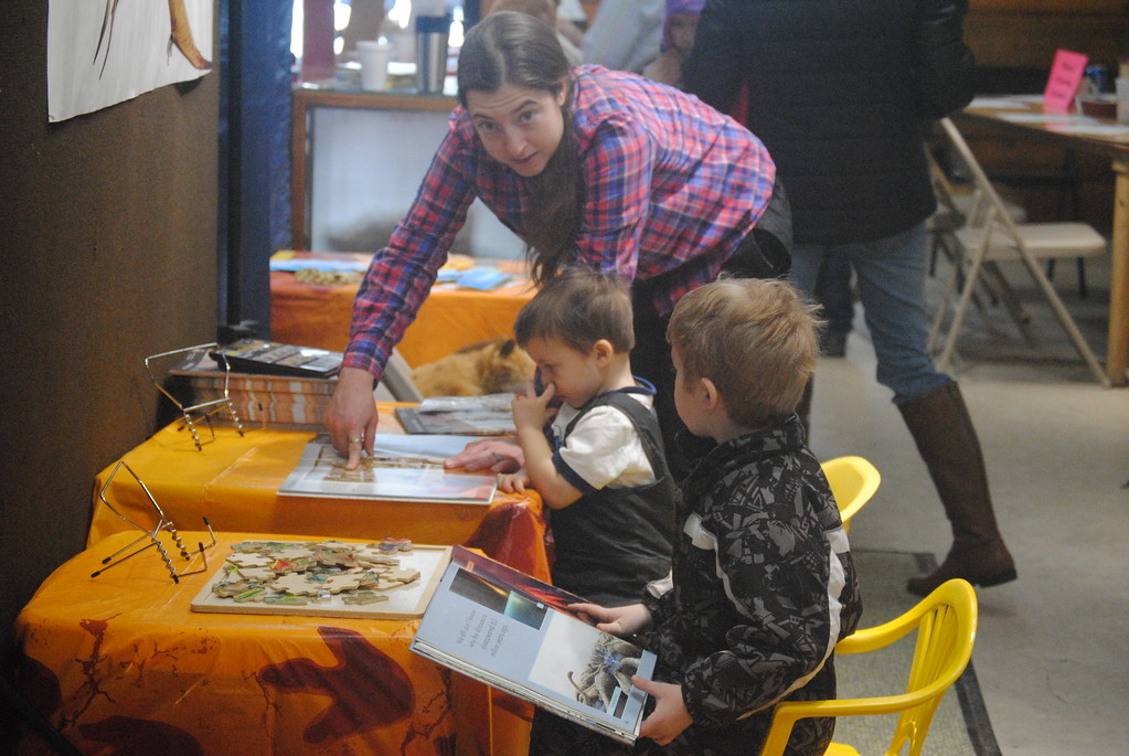 . Leah McDonald - Oneida Daily Dispatch Children learn about dinosaurs at the fossil exhibit at the Winter Hibernation Festival at the Great Swamp Conservancy in Canastota, N.Y., on Saturday, Feb. 11, 2017.