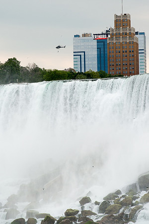 With the Seneca Niagara Resort & Casino sign flashing behind her, Erendira Wallenda flies above Niagara Falls while suspended from a helicopter Thursday morning.