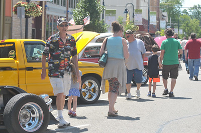 Lisa Yanick Litwiller - Morning Sun -   Cars and motorcycles line the streets of downtown Mt. Pleasant during the Home Builders Association of Central Michigan car show on Saturday, July 15, 2017.