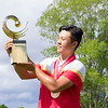 """Yuxin Lin from China receiving his trophy  after winning the Asia-Pacific Amateur Championship tournament 2017 held at Royal Wellington Golf Club, in Heretaunga, Upper Hutt, New Zealand from 26 - 29 October 2017. Copyright John Mathews 2017.    <a href=""""http://www.megasportmedia.co.nz"""">http://www.megasportmedia.co.nz</a>"""