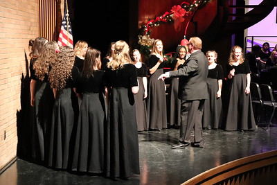 WAHS choral teacher Kent Weaver leads the all-female ensemble, Les Chanteuse.