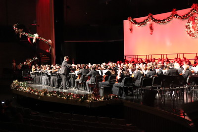 WAHS orchestra director Matthew Radspinner conducts.