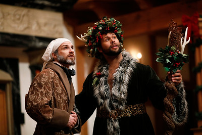 J.C. Long as Ebenezer Scrooge and Topher Embrey as Christmas Present in A CHRISTMAS CAROL.