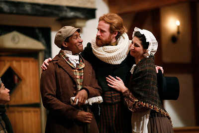 Kyle Powell as Ben Cratchit, Calder Shilling as Bob Cratchit, and Ally Farzetta as Mrs. Cratchit in A CHRISTMAS CAROL.  Photo by Lindsey Walters.