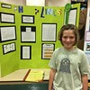 Trillium Charter School fourth grader Audrey Vogel said she tested which solutions grow pea plants the best. She said she likes eating peas but wouldn't eat some of the pea plants because some of them died.<br /> <br /> <br /> (Natalya Estrada- The Times-Standard)
