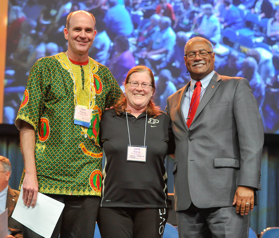 Bishop Julius C. Trimble (right) poses with Glen Robyne (left) and Lana Robyne of Wesley Foundation at Purdue at the Friday Plenary at the 2017 INUMC Annual Conference in Indianapolis.