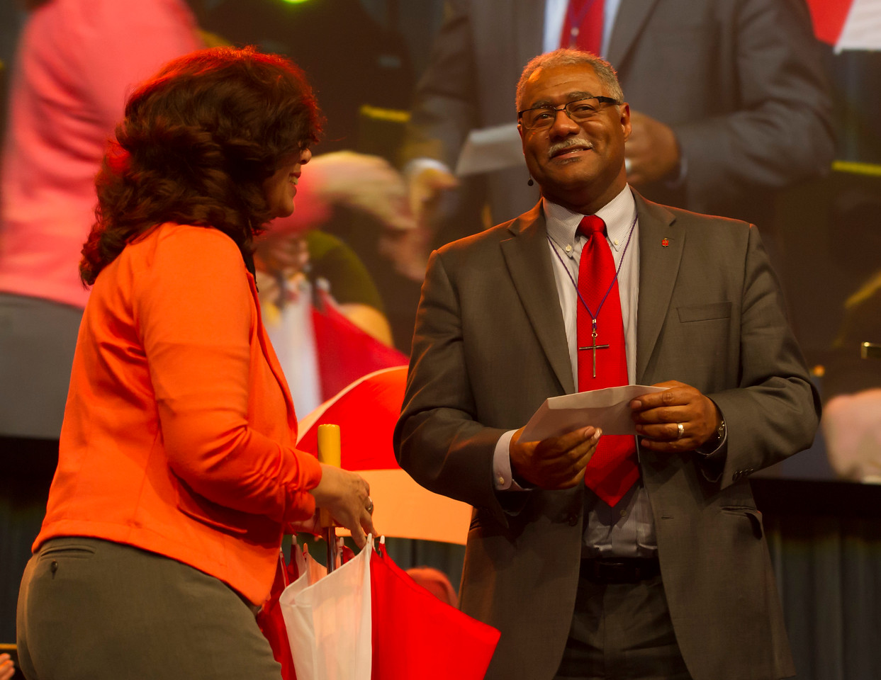 Manet Shettle (left), President of the UM Foundation of Indiana and the Savings and Loan Ministry, presents a check to Bishop Julius C. Trimble at the Friday Plenary at the 2017 INUMC Annual Conference in Indianapolis.