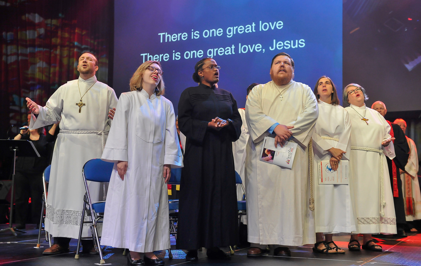 From left, Grant Taylor Merrell, JillAnn Knonenborg, Jennifer Helen Lewis, Khristian Albert McCutchan, Julie Marie Pimlott and Jennifer Dolwick Evans sing at The Commissioning and Ordination Service at the 2017 INUMC Annual Conference in Indianapolis.