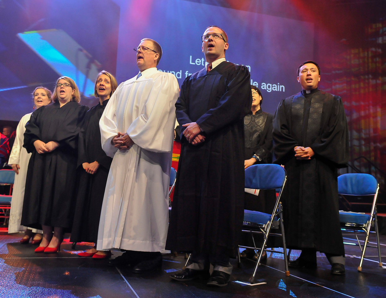 From left, Mary Rebekah Ward Dicken, Crystal A. Jacobson, Adriane Rene Curtis, Brian Edward Cook, Andrew C. Baker, Hye Sook Kim, and Jared Michael Kendall sing at The Commissioning and Ordination Service at the 2017 INUMC Annual Conference in Indianapolis.