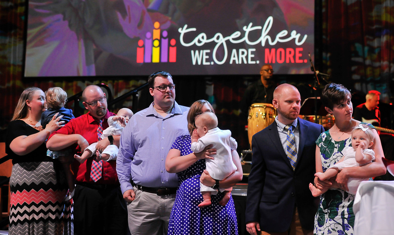 Parents with bablies to be baptized at The Commissioning and Ordination Service at the 2017 INUMC Annual Conference in Indianapolis.