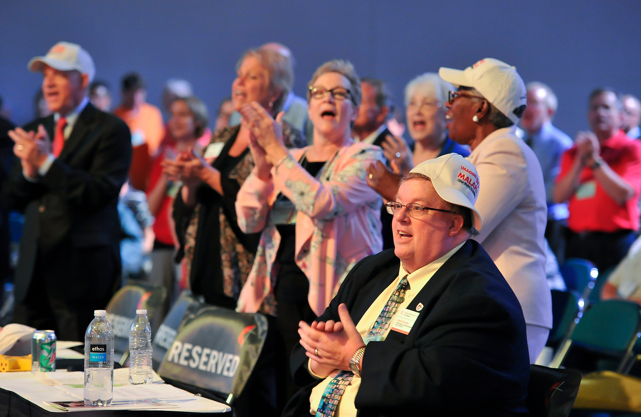 Chris Newman-Jacobs (third from left), Michelle Cobb, and John Groves clap to music at the Friday Plenary at the 2017 INUMC Annual Conference in Indianapolis.