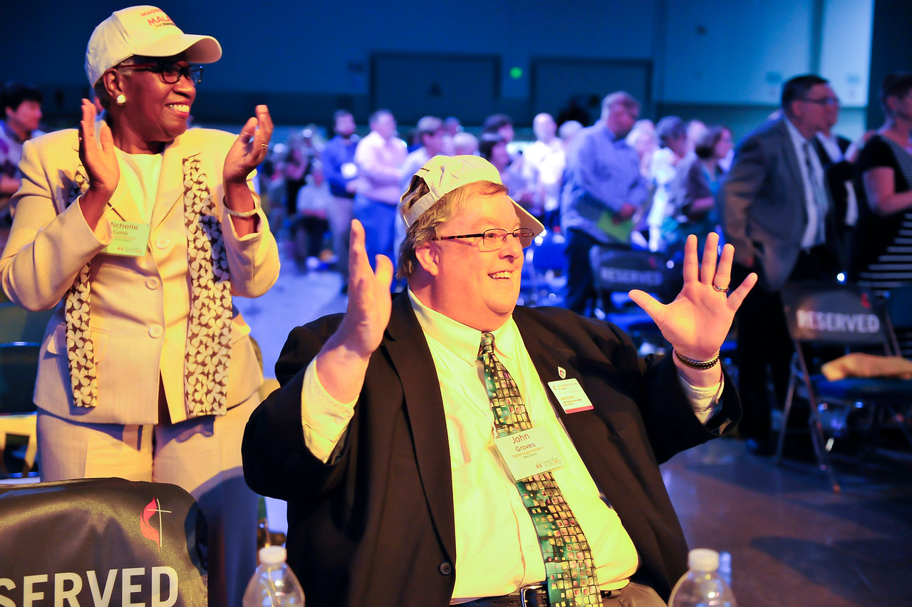 Michelle Cobb, and John Groves clap to music at the Friday Plenary at the 2017 INUMC Annual Conference in Indianapolis.