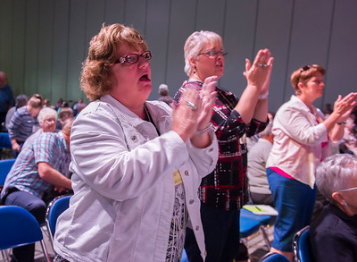 Attendees clap to the music at the Friday Plenary at the 2017 INUMC Annual Conference in Indianapolis.