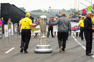The Borg- Warner Indy 500 Trophy Being Delivered to the podium.