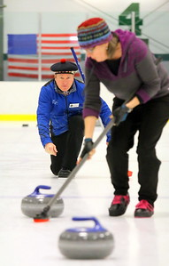 IMG_3487 bob holt follows through on a shot while teammate susanne inglis sweeps