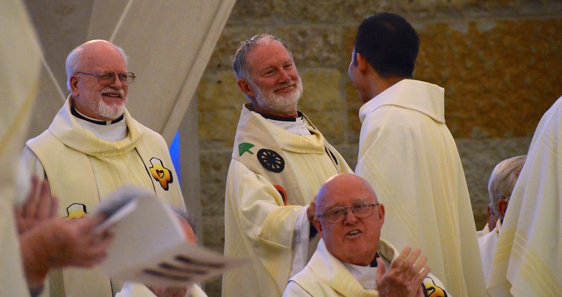Fr. Tim receives congratulations