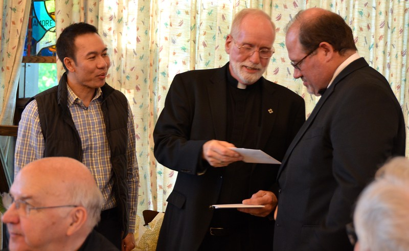 Fr. Ed hands out the jubilarian gifts