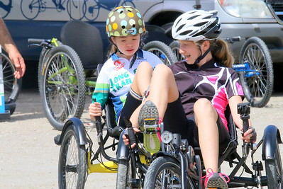 IMG_1755 sabrina latham in front helps her sister natalie,15, to ride