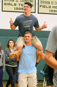 IMG_4993 as senior march in, hunter balch carries cole wescott into the gym