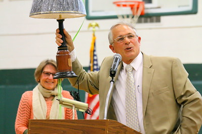 IMG_5226 jim kenison gives his wife nancy a lamp  with an inscription on it at her retirement