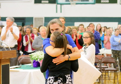 IMG_5068 jen stainton  hugs her daughter ella,10, as teacher of year is  announced