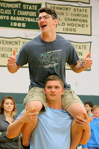 IMG_4996 as senoirs march in, hunter balch carries cole wescott into the gym