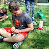 Connor Ahoyt, 10, of Plainfield, pets a rabbit at a petting zoo at the Kendall County Fair on Thursday, Aug. 3. Local farmers and 4-H club members brought a number of animals to the four-day event, some to take part in the petting zoo, and others to enter in competition.