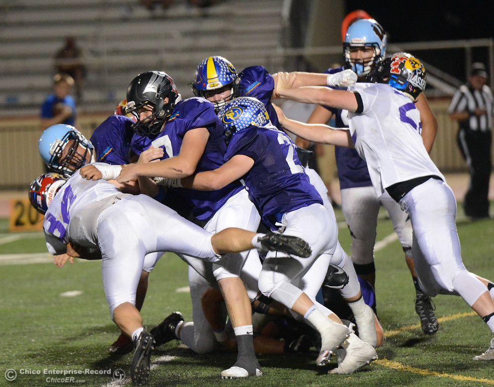 . PV\'s Syrus Tuitele, Colusa\'s Graeson Bell, Sutter\'s Logan Hungrige and Justin Cryer combine to tackle Lassen\'s Colby Harris as the North plays the South in the Lions All-Star Football Game on Saturday, June 17, 2017, in Oroville, California. (Dan Reidel -- Enterprise-Record)