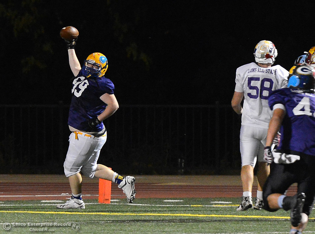 """. Pierce 6\'4\"""" 300-pound lineman Dakota Worl (99) celebrates his 41-yard interception return for a touchdown as the North plays the South in the Lions All-Star Football Game on Saturday, June 17, 2017, in Oroville, California. (Dan Reidel -- Enterprise-Record)"""
