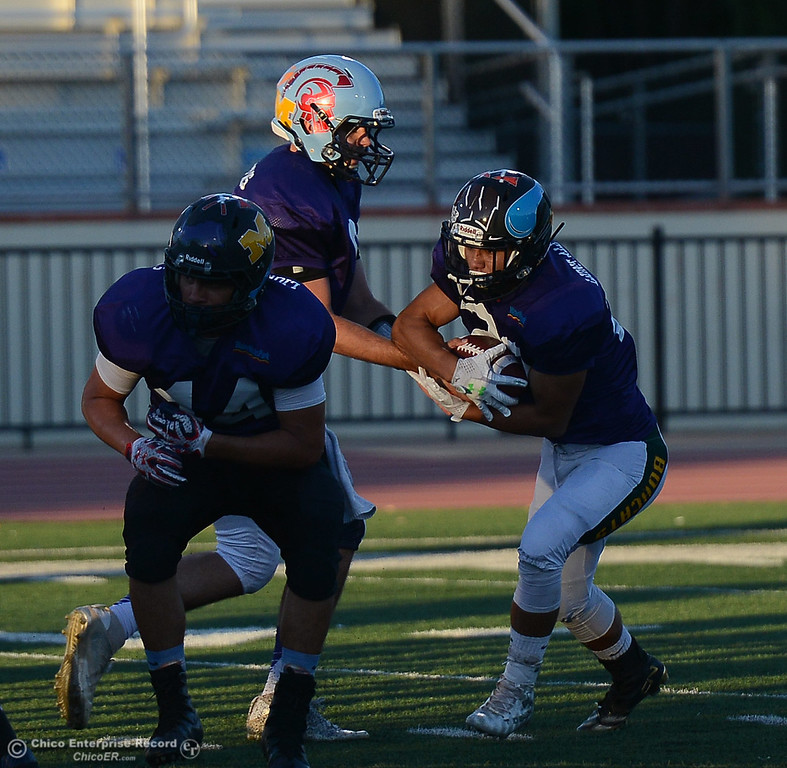 . Austin Garber takes the handoff from QB Kyle Lindquist as Biggs\' Luikini Lualemana (44) looks for a block as the North plays the South in the Lions All-Star Football Game on Saturday, June 17, 2017, in Oroville, California. (Dan Reidel -- Enterprise-Record)
