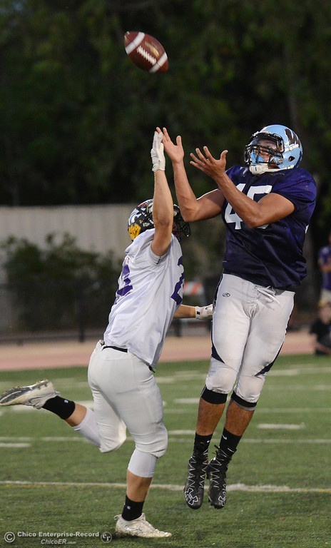 . U Prep\'s Chris Kunz, left, defends a pass to Pleasant Valley\'s Salomon Navarro, right, as the North plays the South in the Lions All-Star Football Game on Saturday, June 17, 2017, in Oroville, California. (Dan Reidel -- Enterprise-Record)