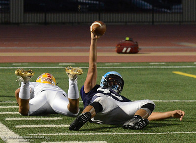 Pleasant Valley's Salomon Navarro holds up the ball after he intercepted it and saved a touchdown by Mt.Shasta's Thairen Sivongsa , left, as the North plays the South in the Lions All-Star Football Game on Saturday, June 17, 2017, in Oroville, California. (Dan Reidel -- Enterprise-Record)