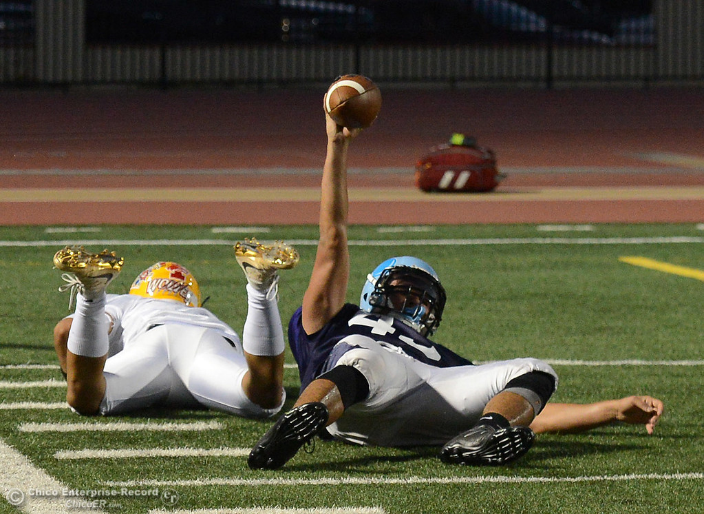 . Pleasant Valley\'s Salomon Navarro holds up the ball after he intercepted it and saved a touchdown by Mt.Shasta\'s Thairen Sivongsa , left, as the North plays the South in the Lions All-Star Football Game on Saturday, June 17, 2017, in Oroville, California. (Dan Reidel -- Enterprise-Record)