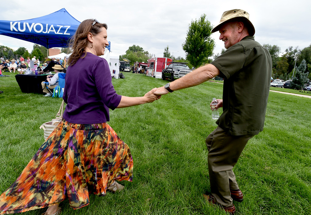 . Merlyn Holmes, left, and Bill McCrossen, dance during the 2017 Longmont Jazz Festival on Saturday at Roosevelt Park. For more photos, go to dailycamera.com.  Cliff Grassmick / Staff Photographer/ July 15, 2017