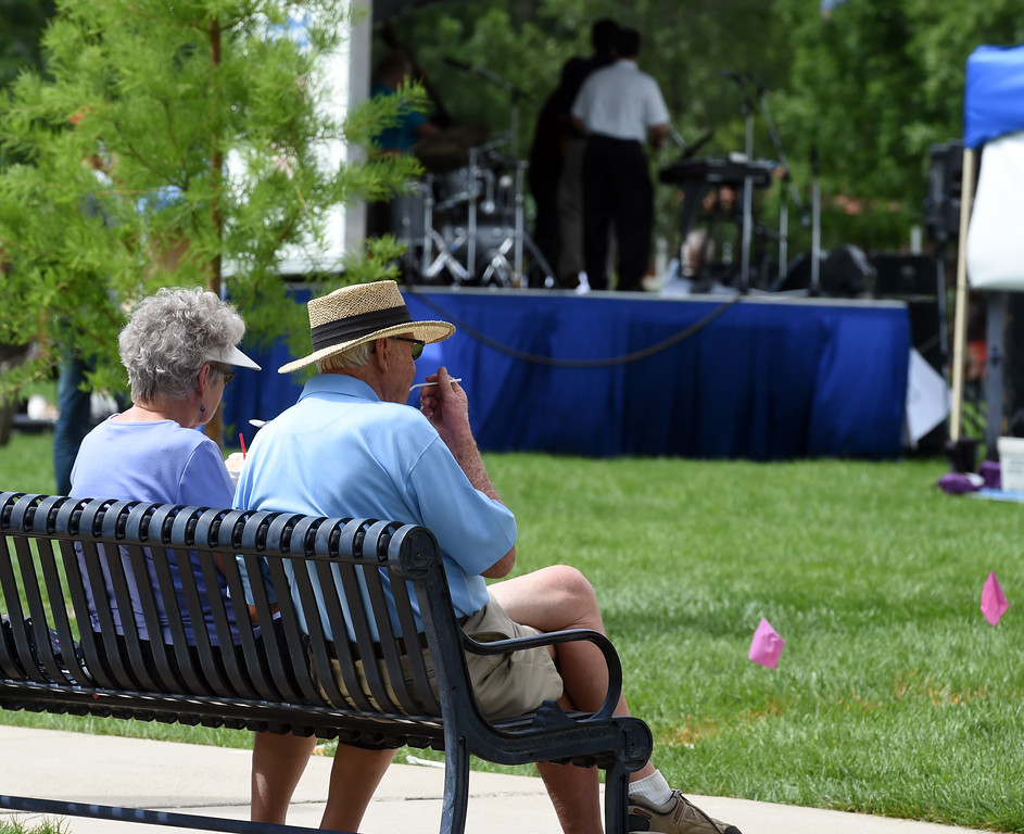 . An elderly couple enjoys ice cream during the 2017 Longmont Jazz Festival on Saturday at Roosevelt Park. For more photos, go to dailycamera.com.  Cliff Grassmick / Staff Photographer/ July 15, 2017