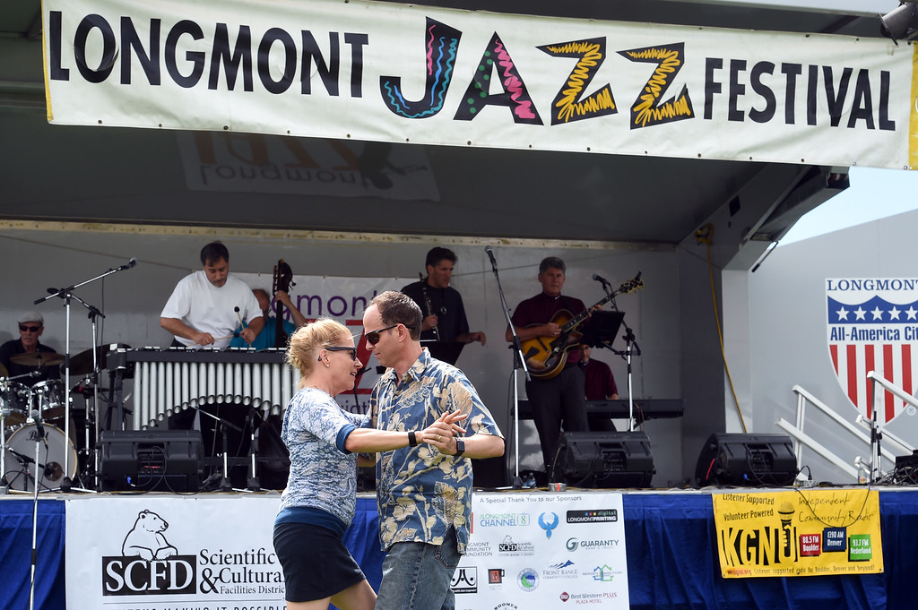 . Dawn and Todd Addleson, of Evergreen, dance during the 2017 Longmont Jazz Festival on Saturday at Roosevelt Park. For more photos, go to dailycamera.com.  Cliff Grassmick / Staff Photographer/ July 15, 2017