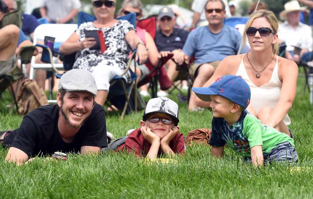 . Adam Murphy, left, Landon Maheux, Porter Maheux, and Amanda Maheux, list to the music during the 2017 Longmont Jazz Festival on Saturday at Roosevelt Park. For more photos, go to dailycamera.com.  Cliff Grassmick / Staff Photographer/ July 15, 2017