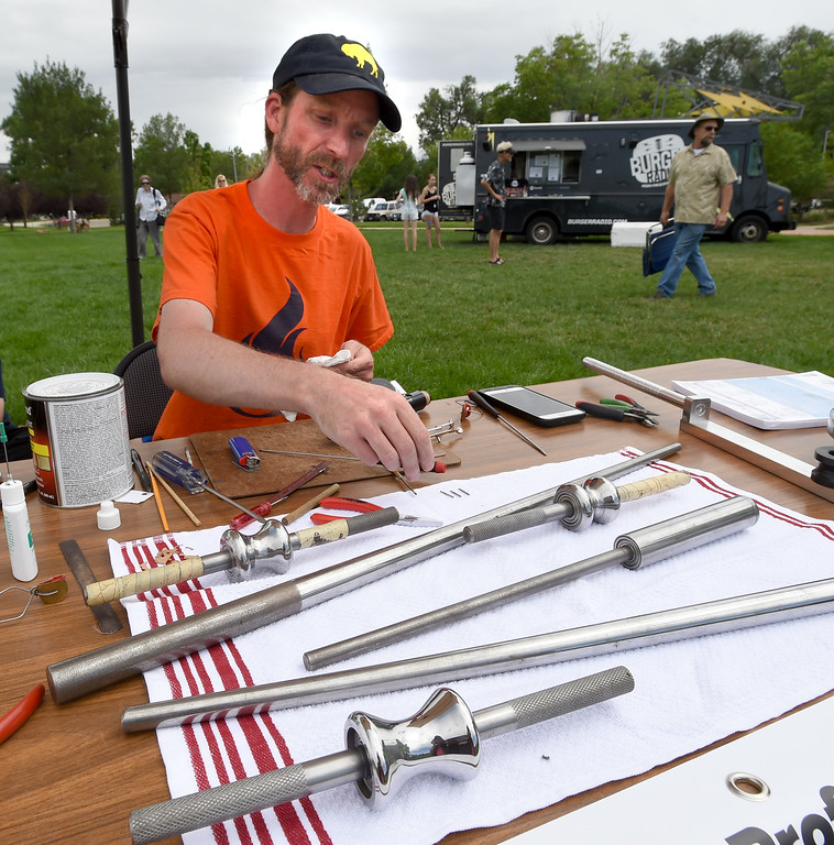 . Nathan Maciejewski, of Front Range Instrument Repair, works on a clarinet during the 2017 Longmont Jazz Festival on Saturday at Roosevelt Park. For more photos, go to dailycamera.com.  Cliff Grassmick / Staff Photographer/ July 15, 2017