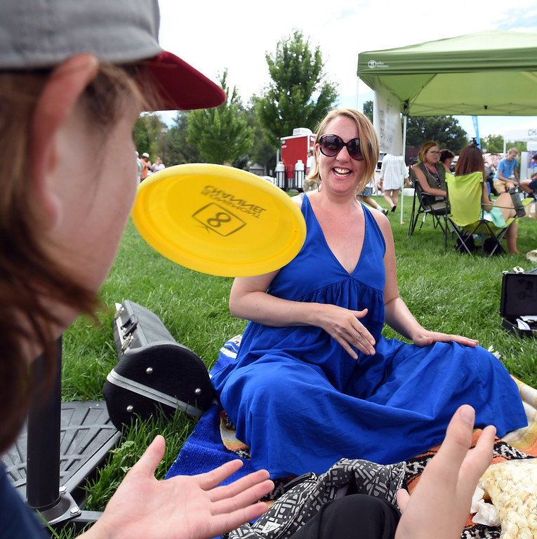 . Lisa Wilson plays sit down flying disc with her son, Otis, during the 2017 Longmont Jazz Festival on Saturday at Roosevelt Park. For more photos, go to dailycamera.com.  Cliff Grassmick / Staff Photographer/ July 15, 2017
