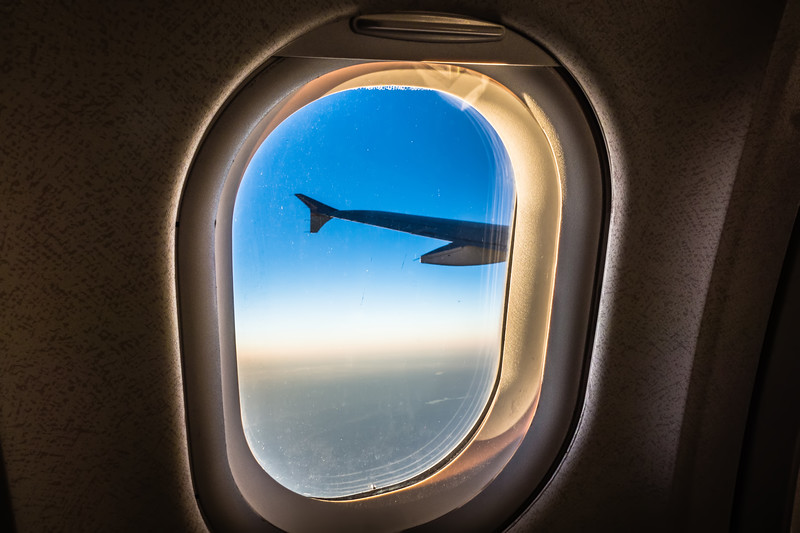 looking out window of an airplane