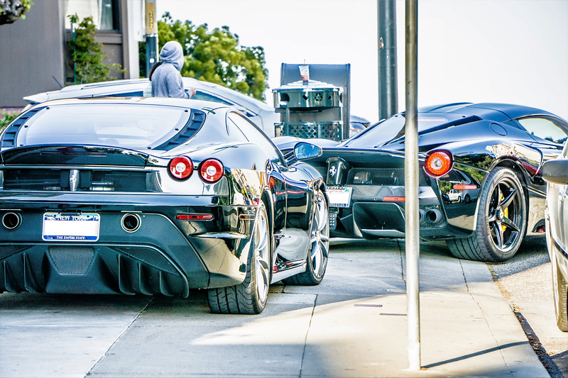 two black ferrarri super cars on streets of san francisco