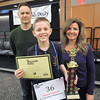 Brendan Pawlicki of St. Lawrence Elementary winner of the 2017 Macomb Daily Spelling Bee holds the individual first-place trophy his parents Christopher and Deanna. DAVID DALTON -- FOR THE MACOMB DAILY