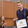 Brendan Pawlicki, a fifth-grader at St. Lawrence Elementary School, reacts to winning the 2017 Macomb Daily Regional Spelling Bee while second-place finisher Phoebe Fraser, an eighth-grader at Immanuel Lutheran School in Macomb Township applauds. DAVID DALTON -- FOR THE MACOMB DAILY
