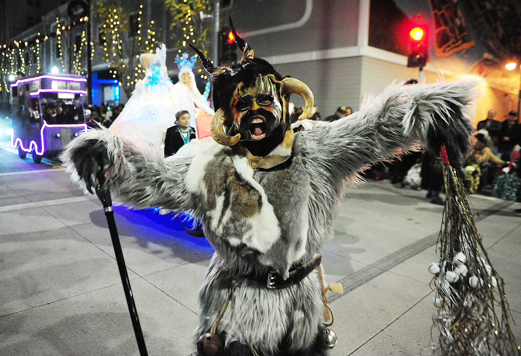 . VALLEJO, CA- DEC. 2, A member of the Beast Bay Krampus scares the crowd during the Mad Hatter Holiday Parade in downtown Vallejo on Saturday. (CHRIS RILEY/Times-Herald)