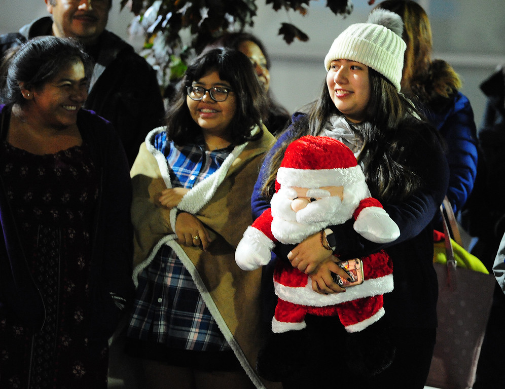 . VALLEJO, CA- DEC. 2, Spectators watch as the Mad Hatter Holiday Parade passes through downtown Vallejo on Saturday. (CHRIS RILEY/Times-Herald)