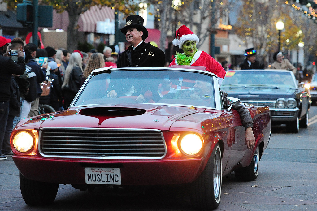 . VALLEJO, CA- DEC. 2, Mad Hatter organizer, Frank Malifrando, and Lisa Gutierrez-Wilson, dressed as The Grinch, ride in a classic Mustang during the Mad Hatter Holiday Parade in downtown Vallejo on Saturday. (CHRIS RILEY/Times-Herald)