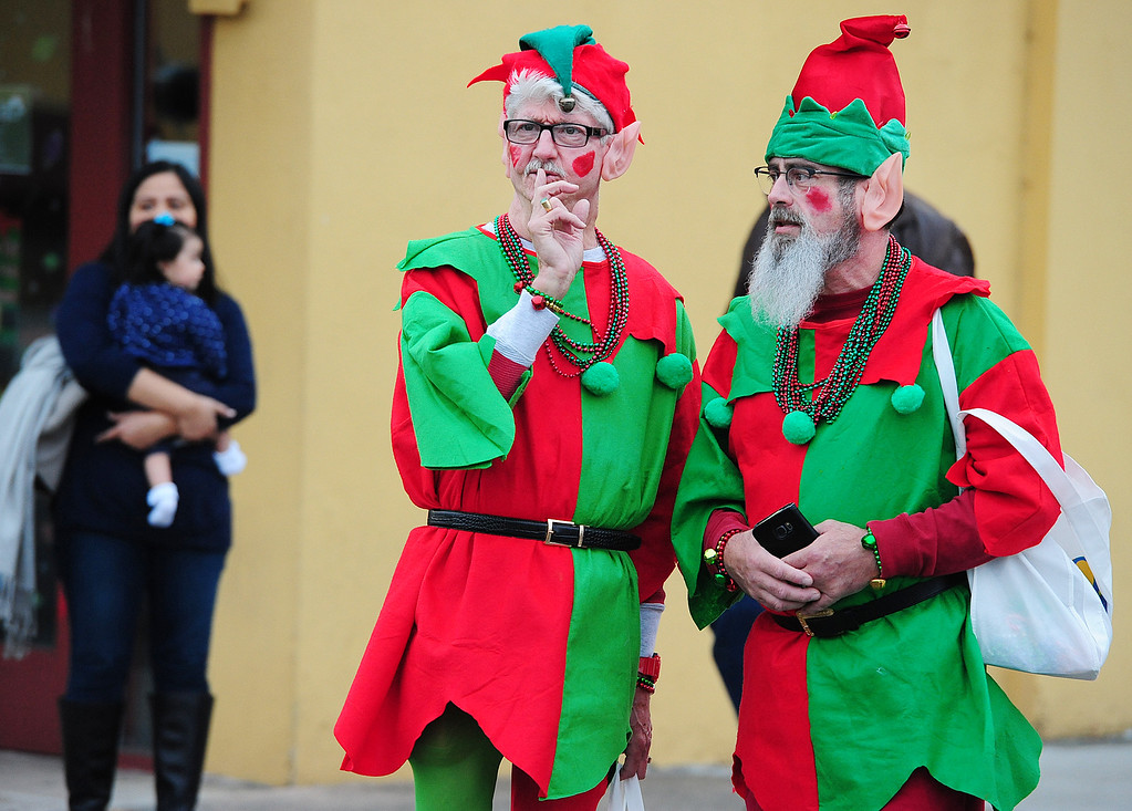 . VALLEJO, CA- DEC. 2, Wendell Quigley and Manny Furtado, right, dressed as elves prepare to walk in the Mad Hatter Holiday Parade in downtown Vallejo on Saturday. (CHRIS RILEY/Times-Herald)