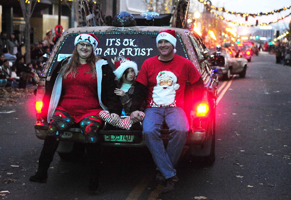 . VALLEJO, CA- DEC. 2, Greg Nett\'s daughter Tristan with her daughter Teagan and boyfriend Cory Albright ride on the back of the late Nett\'s Steampunk Time Traveller truck during the Mad Hatter Holiday Parade in downtown Vallejo on Saturday. (CHRIS RILEY/Times-Herald)